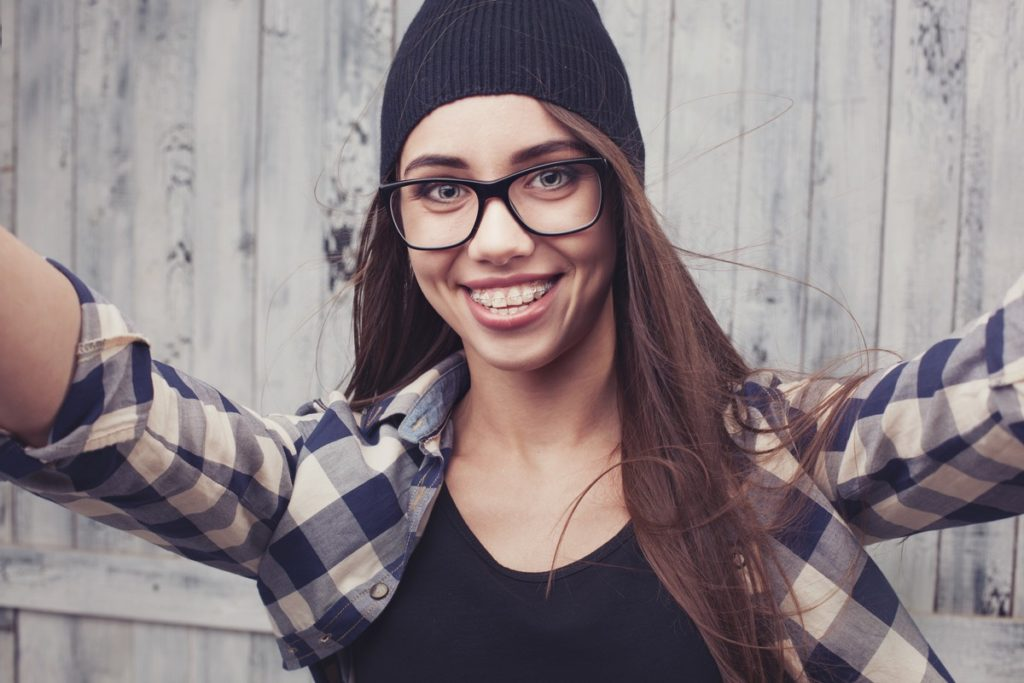 girl in glasses and braces