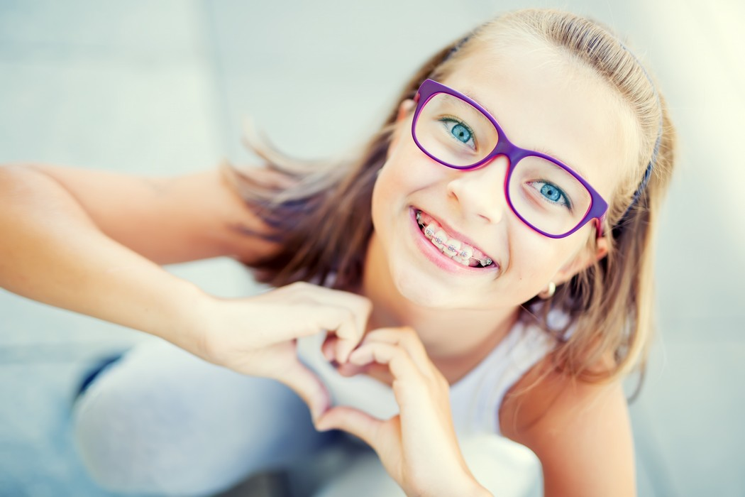 little girl with dental braces and glasses