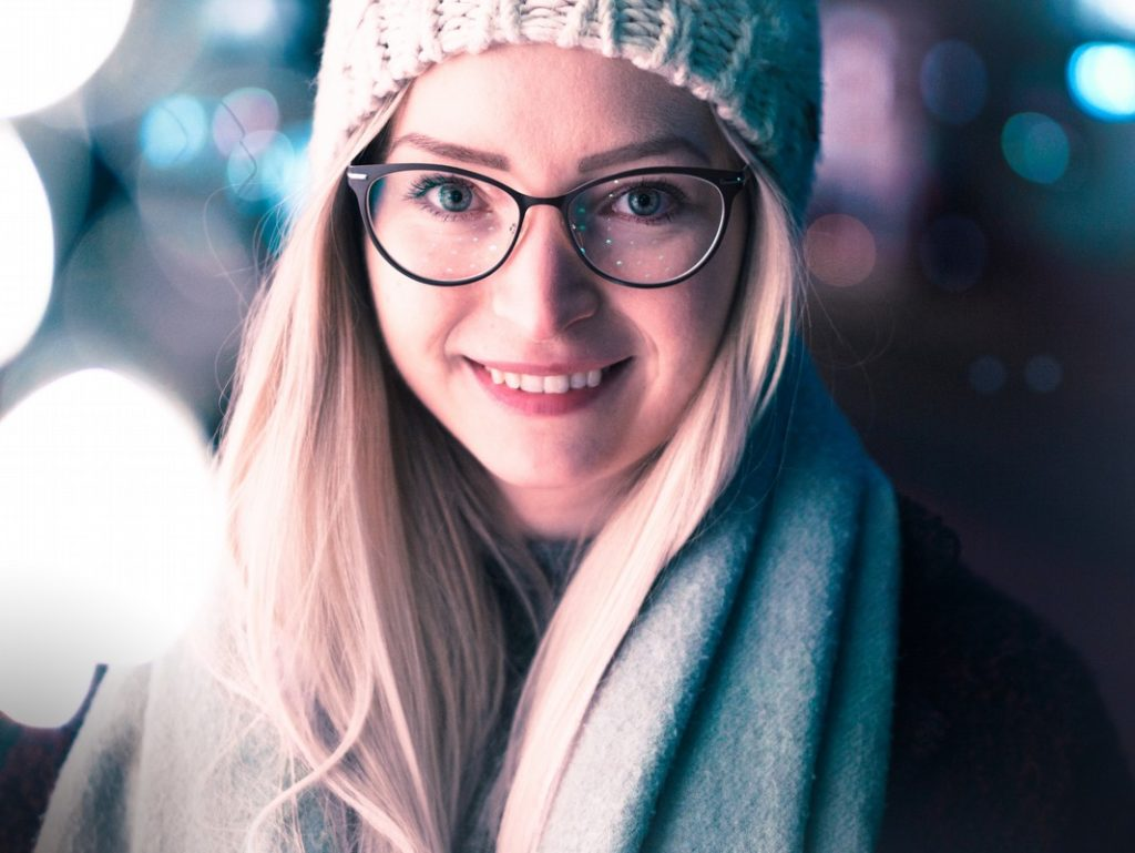 smiling girl wearing black framed eyeglasses