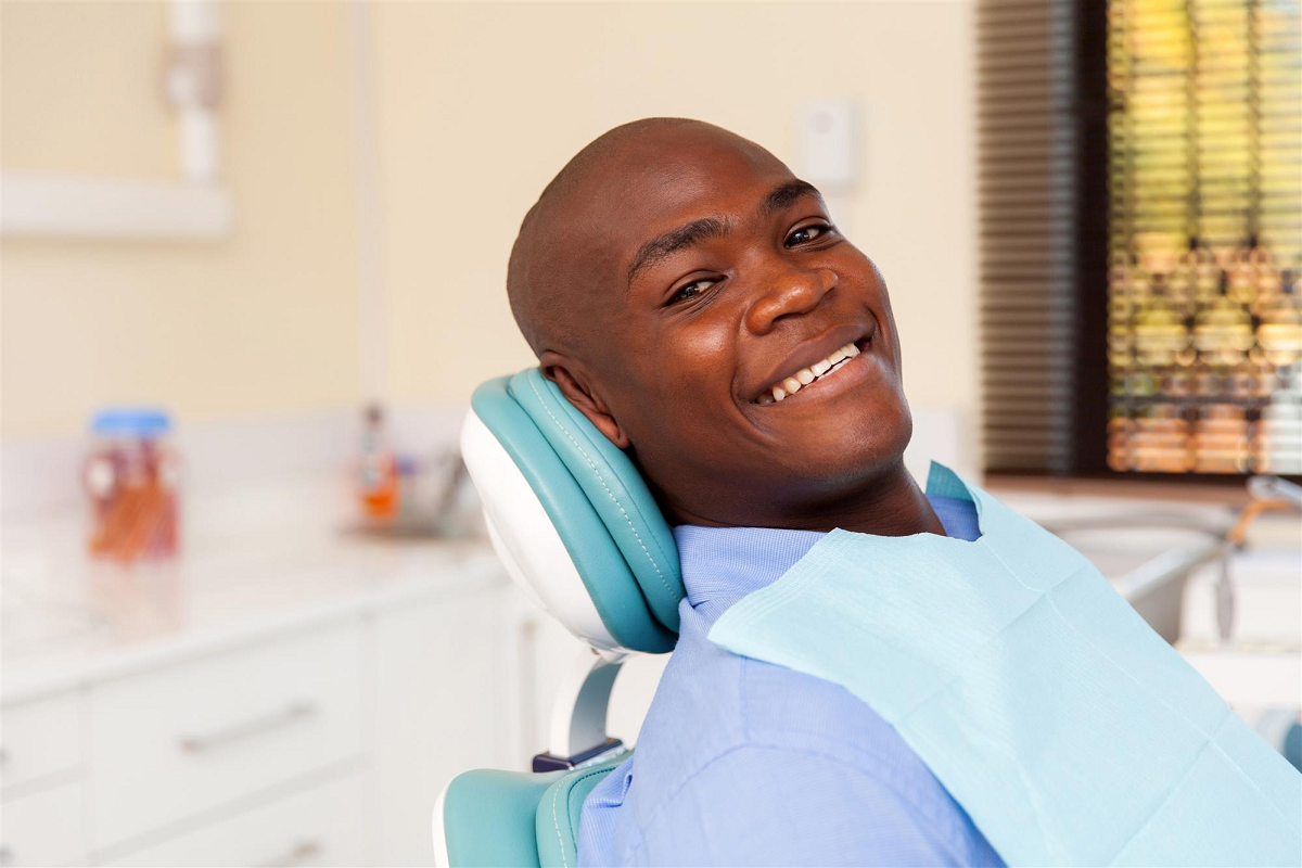 african man visiting dentist