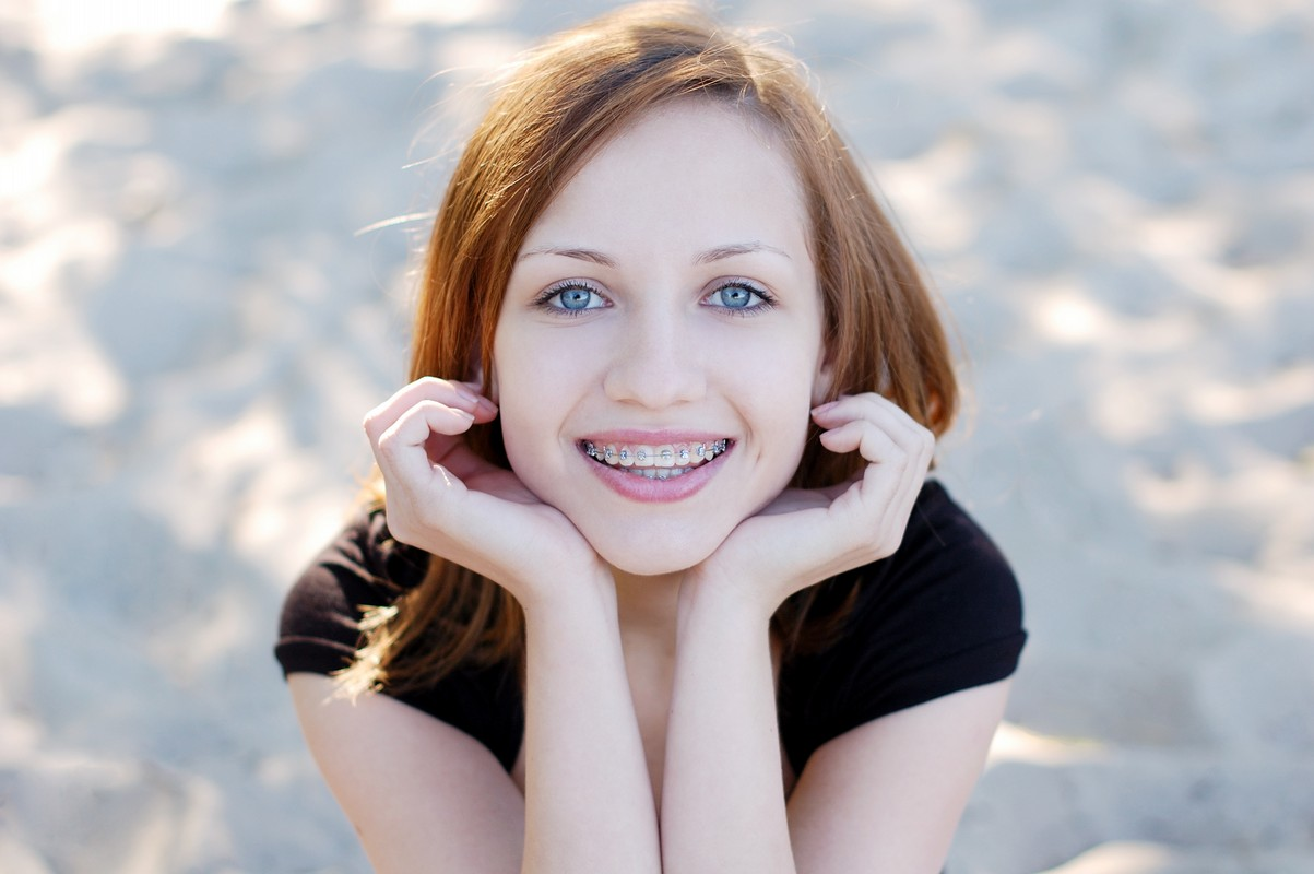 pretty girl wearing braces smiling cheerfully