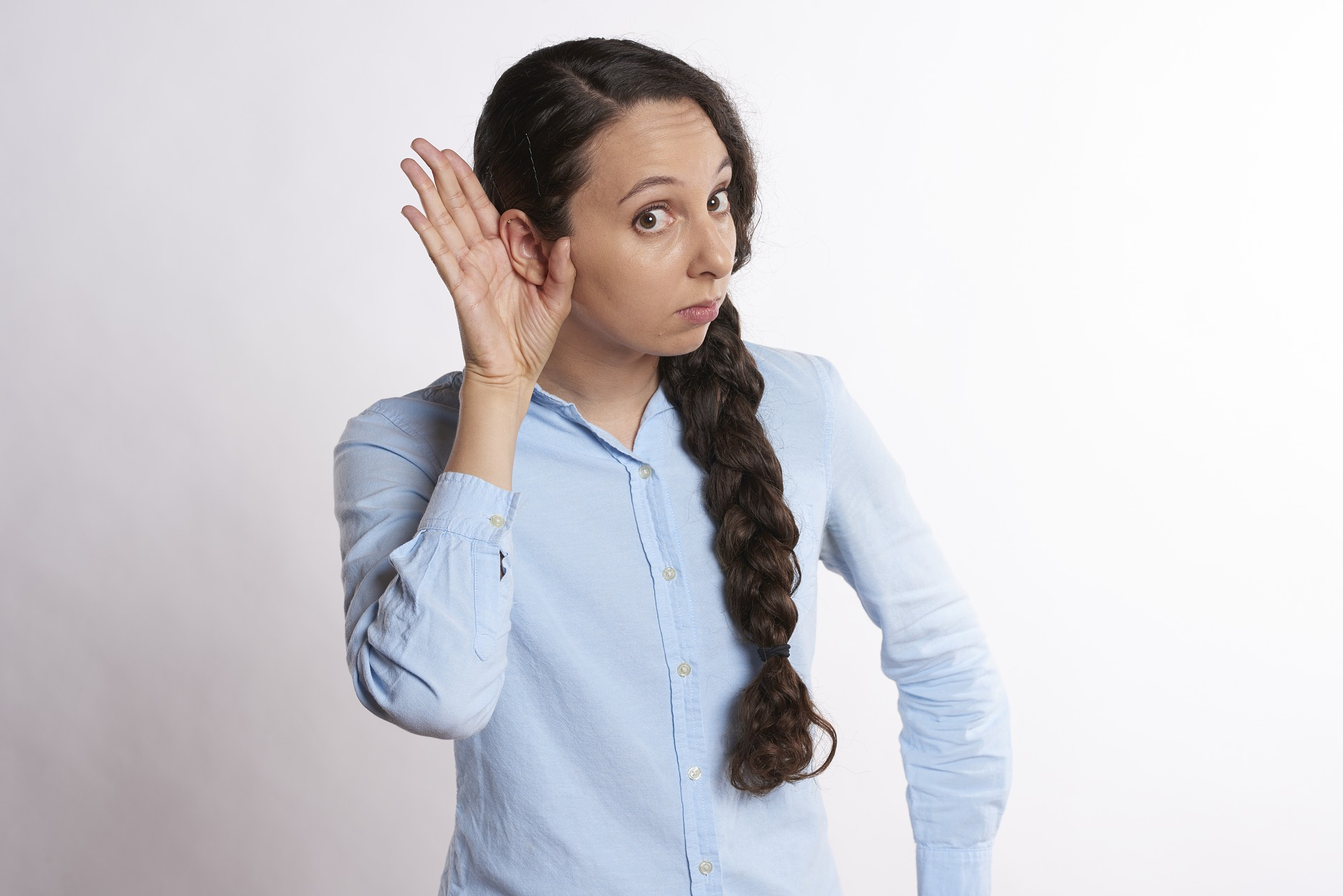 unhappy woman listening ear to bad news