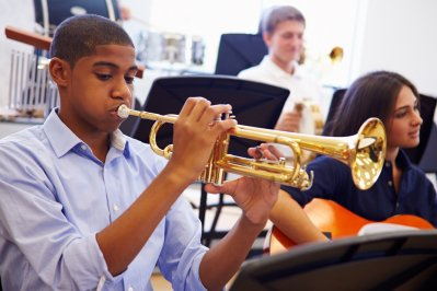boy playing trumpet with braces