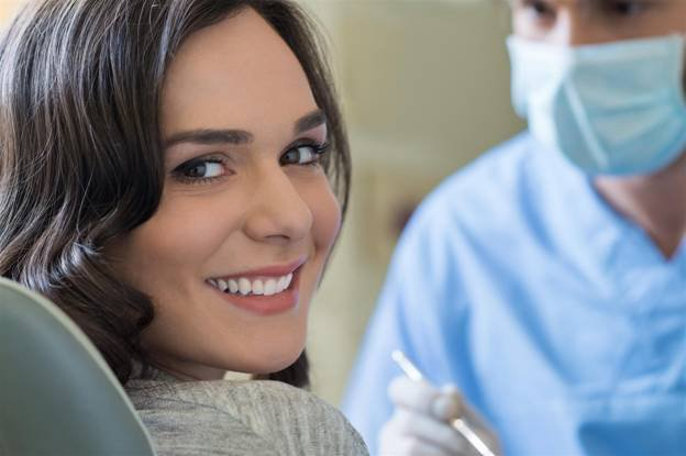 woman smiling with doctor